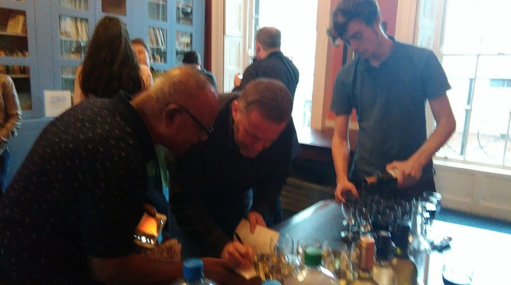 Ross signing his books at the laumch of How to Sleep with Strangers